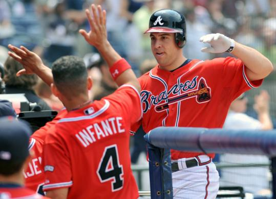 Mark Teixeira celebrates a job well done after hitting his third home run of the game - he connected from both sides of the plate - in Atlanta's win.