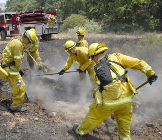 Firefighters doused hot spots near Green Valley, Calif., on