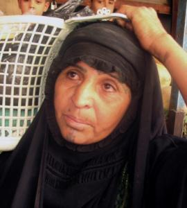 A woman was among the many residents experiencing newfound security on the streets of Basra, Iraq.