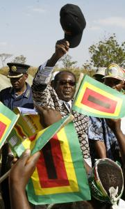 President Robert Mugabe greeted supporters at a rally in Banket, Zimbabwe, yesterday. 'Our people, only our people, will decide, and no one else,' he said.