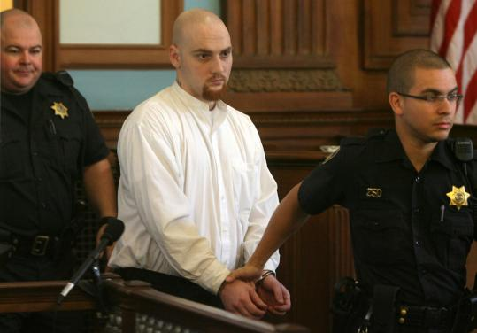 Joshua Davis was led into Providence Superior Court yesterday for his sentencing in the slaying of Savannah Smith in May 2006.