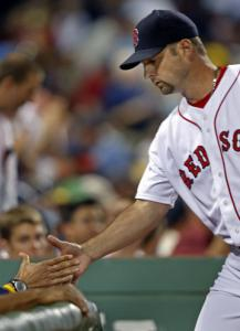 Tim Wakefield gets a hand upon returning to the dugout after the seventh inning.