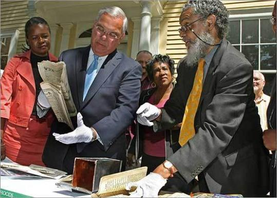 Senator Dianne Wilkerson (above, left), Mayor Thomas M. Menino (middle), and Representative Byron Rushing helped unveil the contents of a 1922 time capsule found on a Dudley Square construction site.