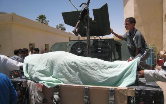 The body of Kamal Abdulsalam, mayor of Karmah, one of 22 killed in a suicide attack, arrived at a hospital in Fallujah.