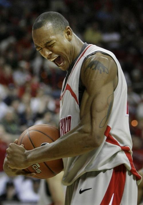 New Mexico's J.R. Giddens celebrates during overtime against Utah at the Mountain West men's basketball tournament in Las Vegas on March 13.