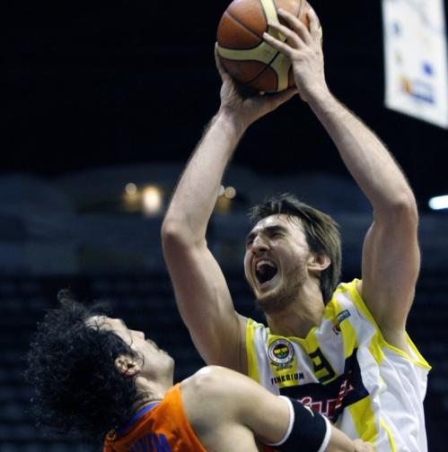 Fenerbahce Ulker Istanbul basketball player Semih Erden, right, drives during a Euroleague game in May.