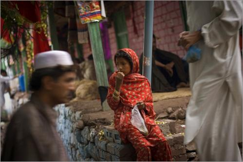 A Pakistani girl eats donated rice during the memorial of Muslim saint Syed Lal Shah next to his shrine in Muree, about 60 kilometers north of Islamabad, Pakistan, Sunday, June 15, 2008.