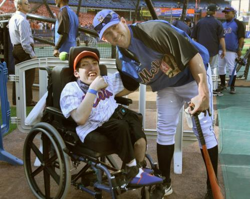 Nixon (right) greets Make A Wish Foundation guest, Adam Russo, before a game against the Seattle Mariners at Shea Stadium.