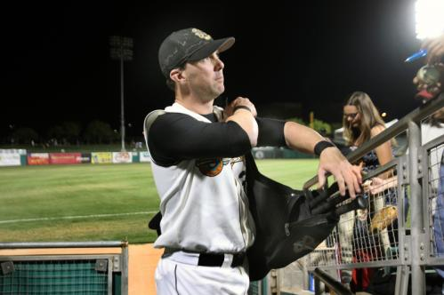 Nixon carries his own bat bag back to the clubhouse after a Triple-A game with the Sidewinders.
