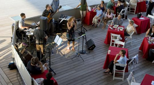 Diners enjoy the music and atmosphere at the ICA's Water Café last year.