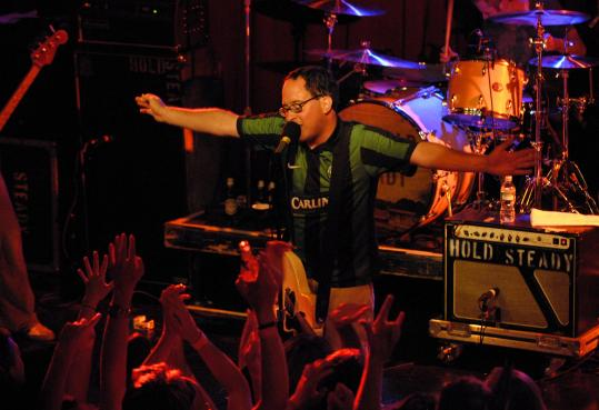 Craig Finn of the Hold Steady plays to the exuberant crowd at the Paradise on Thursday.
