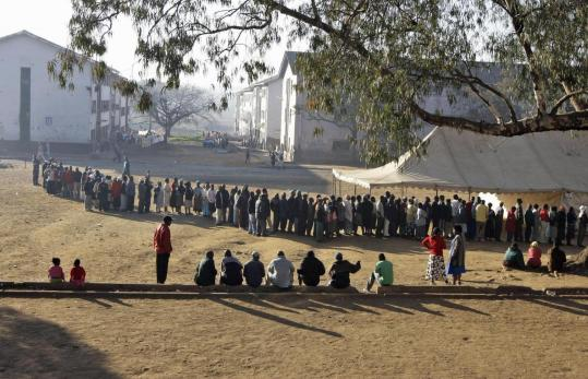 Residents of Mbare, Zimbabwe, lined up to cast votes in the presidential election at a polling station in Harare yesterday.