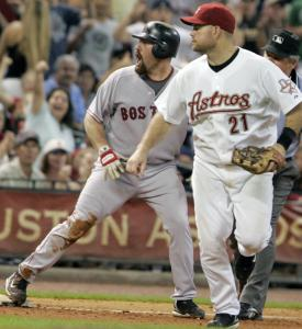 Kevin Youkilis doesn't agree with the verdict after he was called out at third in the sixth inning.