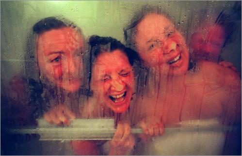Buy this picture! During a Ladies' Night in 1996 at Dillion's Russian Steam Baths in Chelsea, women clown around while looking out of the steam room. Left to right are Jill Chase, Daryll Drew, Patti Felt, and Jean Pomeroy.