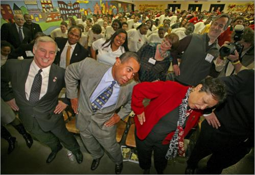 Buy this picture! Massachusetts Gov. Deval Patrick joins a physical training demonstration led by City Year Boston Young Heroes along with First Lady Diane Patrick and DNC Chairman Howard Dean during City Year's Martin Luther King, Jr. Day celebration on Monday, January 15, 2007.