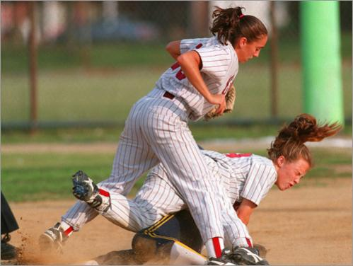 Buy photographs by Pat Greenhouse Notre Dame's Katelyn Beland is safe at second base under the pile of Carver's Julie Kinan, top, and Kim Howland during the 1995 EMass softball semi-final in Brockton.