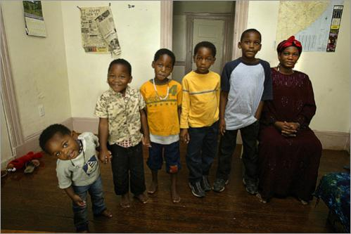 Buy photographs by Pat Greenhouse Halima Abdi Abdulle, 34, poses August 18, 2005, with her children from left: Mumina , 2, Anab, 5, Kaltuma, 6, Abdullahi , 7, and Ibrahim, 9. All the children's last names are Mohamed Uweed. There are concerns that Somali Bantu refugee families have been left in the Boston area without ample resources.