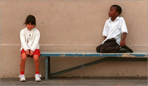 Buy photographs by Pat Greenhouse In the playground of South Park Elementary School in Los Angeles, Cheryl Rivas, 5, left, and Marshawe Hunter, 7, occupy their own worlds. The school went year-round July 1, 1997, and has 71 percent Hispanic and 28 percent African-American enrollment.