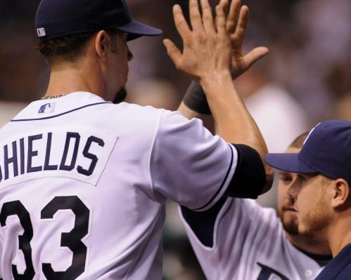 Tampa Bay pitcher James Shields (33) receives high-5's from his teammates.