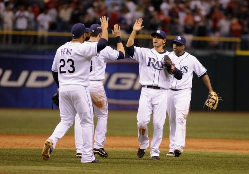 The Tampa Bay Rays celebrate their 5-4 triumph over the Boston Red Sox.