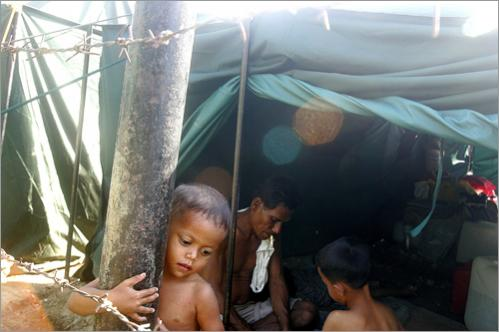 A child living in a government-run refugee camp on the grounds of a mosque in Aceh Besar, Indonesia.
