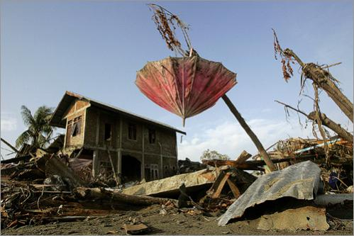 An umbrella sits among the remains of homes in Banda Aceh, Indonesia.