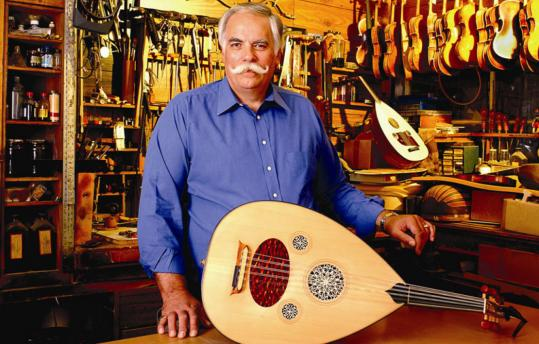 Peter Kyvelos, in his Belmont shop, with an oud, one of which on display in 'Keepers of Tradition' at the National Heritage Museum.