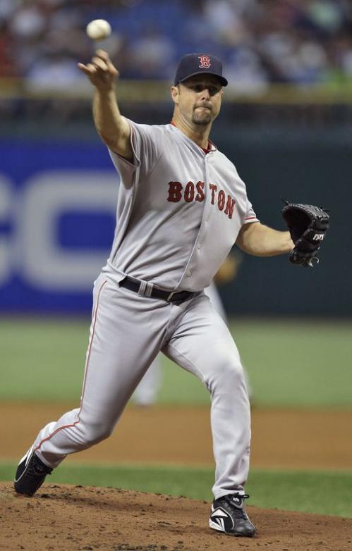 Boston Red Sox pitcher Tim Wakefield throws a knuckleball against Tampa Bay Rays during the first inning.