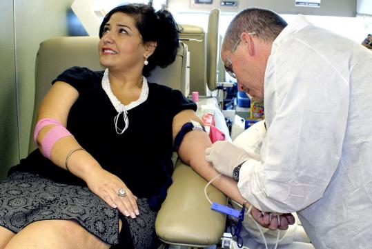 First-time blood donor Amanda Lopez of Las Cruces, N.M., takes advantage of a United Blood Services offer of a 5-gallon gas voucher for a pint of blood to the first 20 people to sign up.