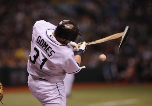 Tampa Bay pinch hitter Jonny Gomes (31) breaks a bat.