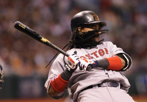 Designated hitter Manny Ramirez ducks from an inside pitch.