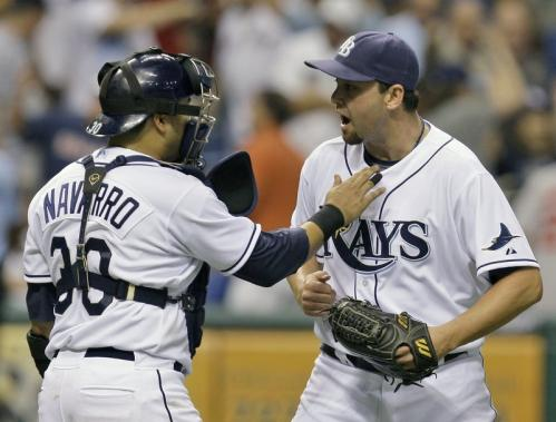 Tampa Bay Rays pitcher Dan Wheeler, right, celebrates with catcher Dioner Navarro after closing out the Boston Red Sox.