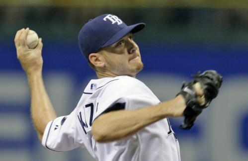 Tampa Bay Rays pitcher Scott Kazmir throws a first inning pitch to Boston Red Sox batter J.D. Drew.