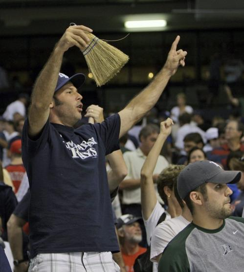 Tampa Bay Rays fans celebrate after the team swept a three-game series from the Boston Red Sox.
