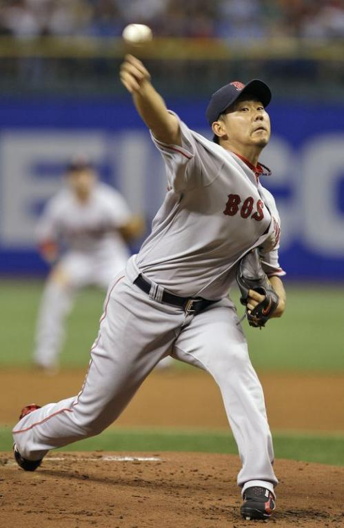 Boston Red Sox pitcher Daisuke Matsuzaka delivers to Tampa Bay Rays' Carl Crawford during the second inning.