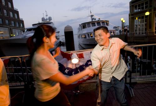 Boating, anyone? Mike and Brittany Chen of Jamaica Plain danced in front of the yachts docked at Rowes Wharf. Brittany Chen said swing music sometimes pops up on the couple's home playlist. 'It's great for dinner parties,' she added. See more pics from this event More info on the Boston Harbor Hotel SUBMIT Your nightlife photos! TALK What scene should we visit next?