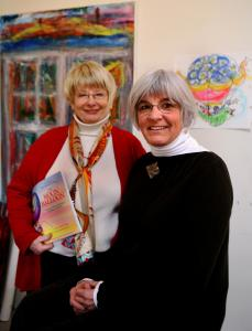 Joan Drescher (left) and Liz Ennis, founder and codirector of the Moon Balloon Project, work with children and caregivers to help deal with the stress of long-term illness.