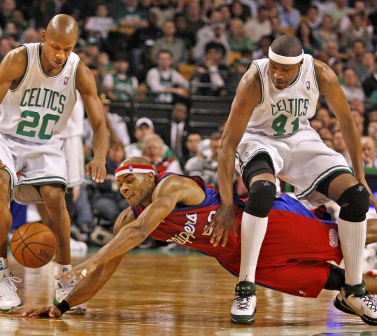 A thing of the past? Potential Celtic Corey Maggette went all out against Ray Allen (left) and James Posey last season. If Maggette joins Boston, there probably won't be room to keep Posey.