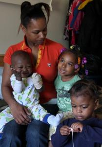 Margo Kindred - with her grandchildren (from left), NaZair Kindred, 11 months; NaZharea Kindred, 3; and NaZeon Kindred, 2 - couldn't get welfare benefits in Michigan without her Colorado birth certificate.