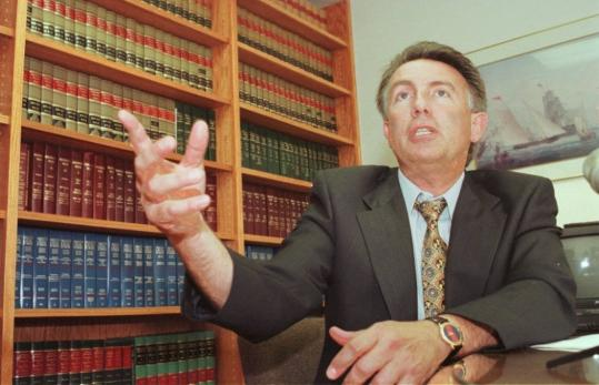 Lawrence W. Frisoli spoke in his Cambridge office in August 2000 after a jury awarded the family of Jeffrey Curley, a 10-year-old murder victim, $328 million in a wrongful death suit.
