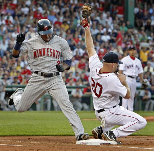 Minnesota's Denard Span is out on a close play at first to end the top of the second inning as Red Sox first baseman Kevin Youkilis makes a nice save of an off-target throw from SS Julio Lugo.