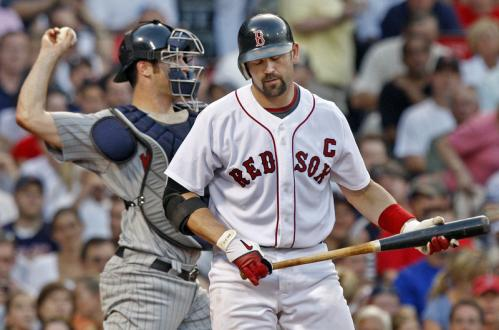 Red Sox catcher Jason Varitek heads back to the dugout after striking out in the third inning.