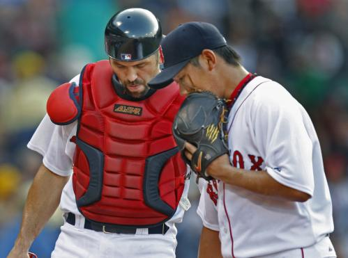 Red Sox starting pitcher Daisuke Matsuzaka (right) chats with Jason Varitek before wiggling out of a first-inning jam.