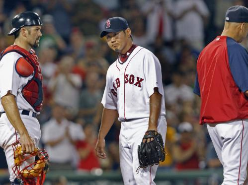 Red Sox starting pitcher Daisuke Matsuzaka, center, with catcher Jason Varitek and manager Terry Francona, departs after carrying a shutout into the eighth inning.