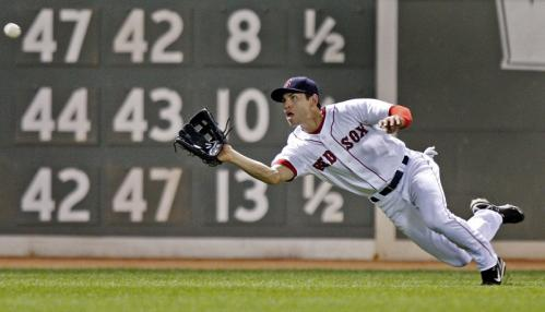 Red Sox left fielder Jacoby Ellsbury makes a nice diving catch to rob the Twins Carlos Gomez of a leadoff hit in the top of the eighth inning.