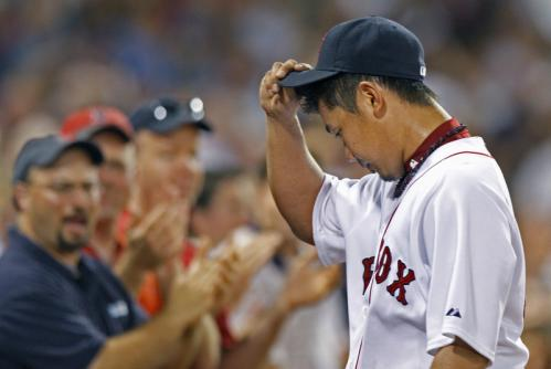 Red Sox starter Daisuke Matsuzaka tips his cap to the applauding fans as he leaves the game in the eighth inning.