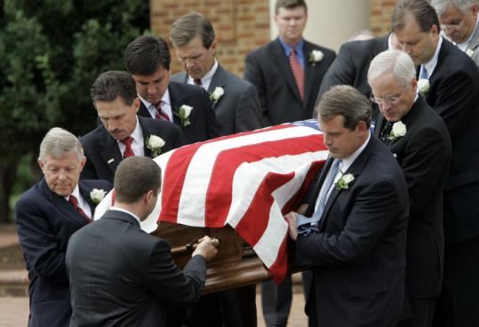 Senator Jesse Helms's casket was carried from Hayes Barton Baptist Church after the funeral yesterday in Raleigh, N.C.