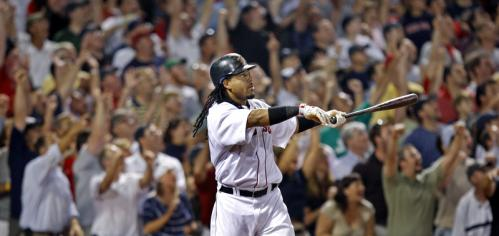 Red Sox slugger Manny Ramirez brought the crowd to its feet with a game-tying, two-run homer in the eighth inning that helped Boston rally for a 6-5 triumph over the Twins Tuesday at Fenway Park. Stroll through our gallery for more scenes from the game.
