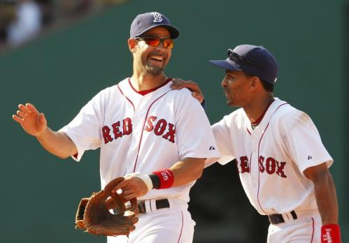 Mike Lowell (left) and Julio Lugo share a laugh at the end of the Red Sox' 18-5 win over the Minnesota Twins, which completed a three-game sweep at Fenway Park on Wednesday.