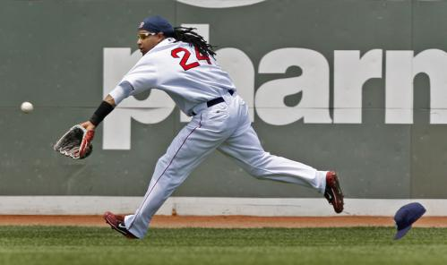 Red Sox left fielder Manny Ramirez made a nice running catch to rob the Twins' Denard Span of a hit to end the top of the second inning ...